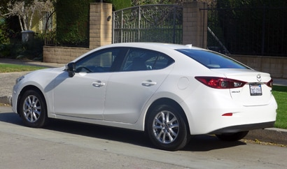 A three-quarter rear view of the 2014 Mazda 3 4-Door