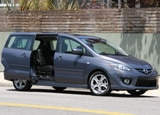 A three-quarter front view of a 2008 Mazda 5 Grand Touring