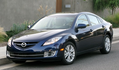 A three-quarter front view of a Kona Blue 2010 Mazda 6 i Sedan Touring Plus