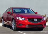 A three-quarter front view of a 2014 Mazda 6 Touring