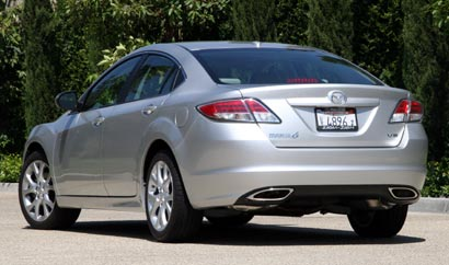 A three-quarter rear view of a silver 2009 Mazda 6 S Grand Touring