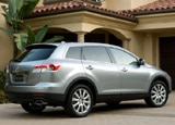 A three-quarter rear view of a 2009 Mazda CX-9 Sport