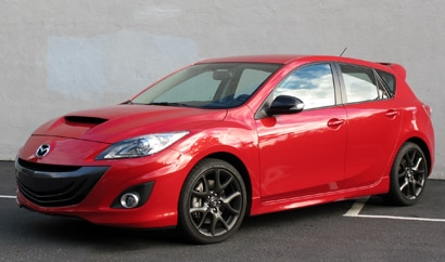 A three-quarter front view of a red 2013 Mazda Mazdaspeed3 Touring