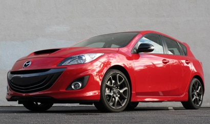 A three-quarter front view of a 2013 Mazda Mazdaspeed3 Touring