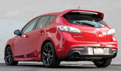 A three-quarter rear view of a red 2013 Mazdaspeed3 Touring