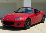 A three-quarter front view of a red 2012 Mazda MX-5 Miata Special Edition PRHT