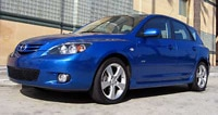 A front three-quarter view of a blue 2004 Mazda 3