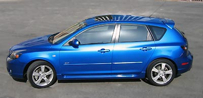 A side view of a blue 2004 Mazda 3