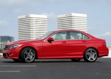 A side view of a Mars Red 2010 Mercedes-Benz C63