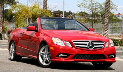 A three-quarter front view of a red 2010 Mercedes-Benz E550 Cabriolet