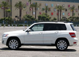 A side view of a white 2010 Mercedes-Benz GLK350 4MATIC