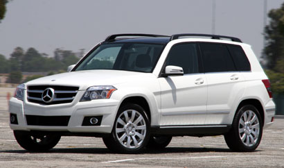 A three-quarter front view of a white 2010 Mercedes-Benz GLK350 4MATIC
