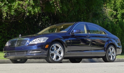 A three-quarter front view of a 2012 Mercedes-Benz S400 HYBRID Sedan