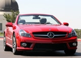 A front view of a red 2009 Mercedes-Benz SL63 AMG by Los Angeles' Griffith Park Observatory