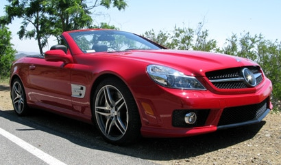 A red 2009 Mercedes-Benz SL63 AMG along the road near Los Angeles' Griffith Park Observatory