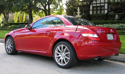 A three-quarter rear view of a red 2005 Mercedes-Benz SLK350