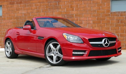 A three-quarter front view of a red 2012 Mercedes-Benz SLK350