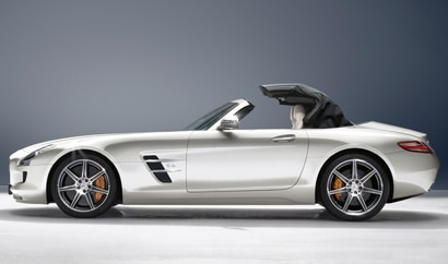A side view of a silver 2012 Mercedes-Benz SLS AMG Roadster