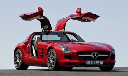 A three-quarter front view of a red 2011 Mercedes-Benz SLS AMG