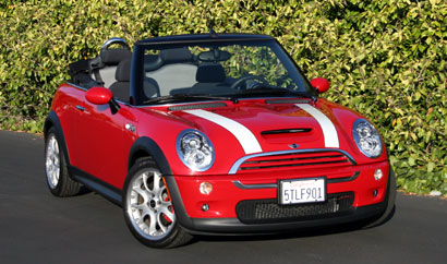A three-quarter front view of a red and white 2006 Mini Cooper S Convertible John Cooper Works