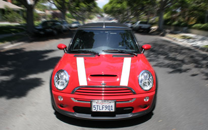 A front view of a red and white 2006 Mini Cooper S Convertible John Cooper Works