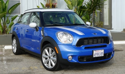 A three-quarter front view of a blue 2011 Mini Cooper S Countryman ALL4