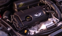 The 1.6-liter turbocharged inline 4-cylinder engine of the 2012 Mini Cooper S Coupe