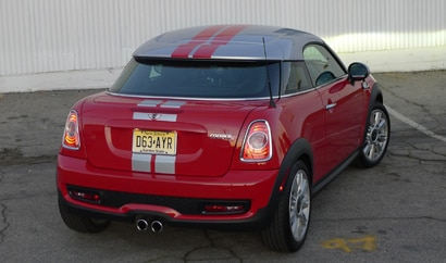A three-quarter rear view of a red 2012 Mini Cooper S Coupe