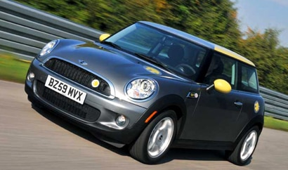 A three-quarter front view of a 2011 Mini E in action