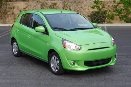 A three-quarter front view of a 2014 Mitsubishi Mirage