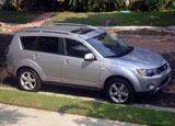 A side view of a 2007 Mitsubishi Outlander XLS