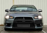 A front view of a 2013 Mitsubishi Lancer Evolution GSR