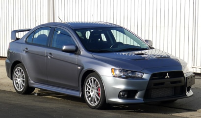 A three-quarter front view of a 2013 Mitsubishi Lancer Evolution GSR