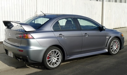A three-quarter rear view of a 2013 Mitsubishi Lancer Evolution GSR