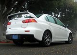 A three-quarter rear view of a white 2008 Mitsubishi Lancer Evolution MR