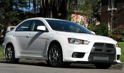 A three-quarter front view of a white 2008 Mitsubishi Lancer Evolution MR