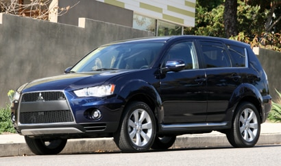 A three-quarter front view of a 2010 Mitsubishi Outlander GT