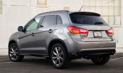 A three-quarter rear view of the 2013 Mitsubishi Outlander Sport