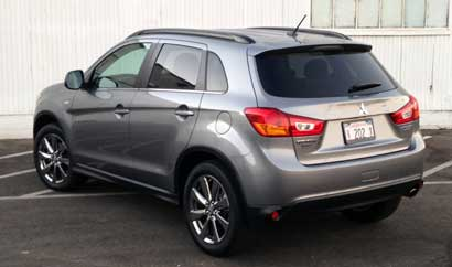 A three quarter rear view of a  2015 Mitsubishi Outlander Sport