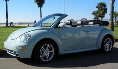 A three-quarter front view of a blue 2004 Volkswagen New Beetle Convertible GLS 1.8T