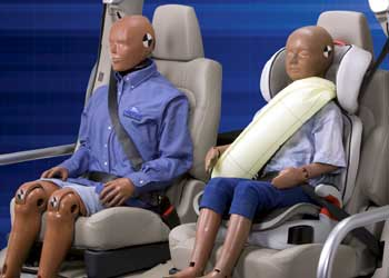 Crash-test dummies wearing Ford's rear-seat inflatable seatbelts
