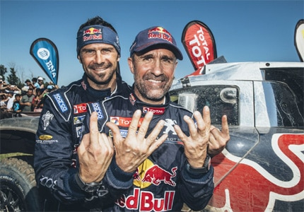 Team Peugeot Total of Red Bull clinch the victory at Dakar Rally 2016 and Peterhansel celebrates his 12th career title