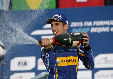 Sebastien Buemi celebrates his victory at the Beijing ePrix with a bottle of G.H. Mumm Champagne