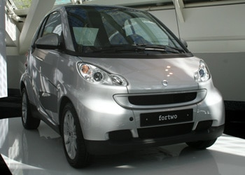 A three-quarter front view of a silver 2008 smart fortwo passion coupe