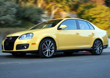 A three-quarter front view of a yellow 2007 Volkswagen Jetta GLI Fahrenheit
