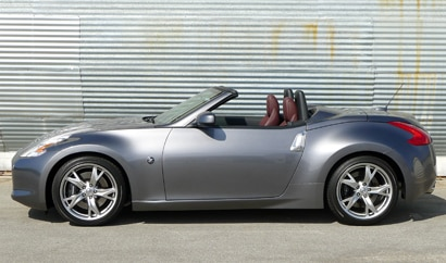 A side view of a silver 2011 Nissan 370Z Roadster