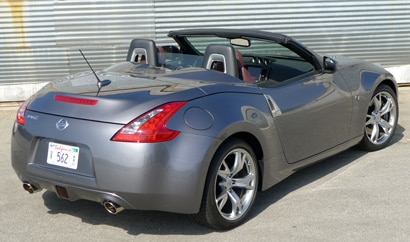 A three-quarter rear view of a 2011 Nissan 370Z Roadster Touring