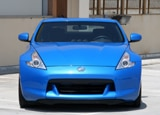 A front view of a blue 2010 Nissan 370Z Coupe
