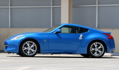 A side view of a blue 2010 Nissan 370Z Coupe