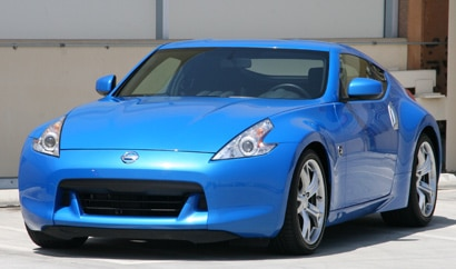 A three-quarter front view of a blue 2010 Nissan 370Z Coupe